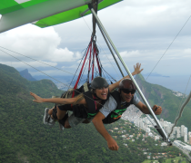 Hang Gliding in Rio with the Corcovado and dark clouds